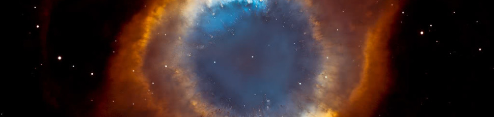 "This composite picture of the Helix Nebula is a seamless blend of nine ultra-sharp images from the Hubble Space Telescope's Advanced Camera for Surveys with the wide-field view of the Mosaic Camera on the WIYN 0.9-meter telescope at Kitt Peak National Observatory.  One of the largest and most detailed celestial images ever made, the picture was released on May 9 by the Space Telescope Science Institute and NOAO in honor of Astronomy Day 2003, which took place the following day.  The radiant ""tie-die"" colors of the planetary nebula, located in the constellation Aquarius about 650 light-years distant from Earth, correspond to glowing oxygen (blue) and hydrogen and nitrogen (red).  Image Credit: NASA, NOAO, ESA, the Hubble Helix Nebula Team, M. Meixner (STScI), and T.A. Rector (NRAO)"